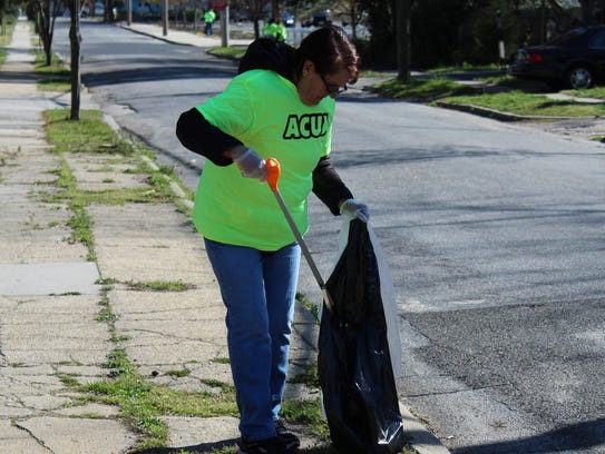 Phyllis Jones, a member of Victory Bible Church, cleans