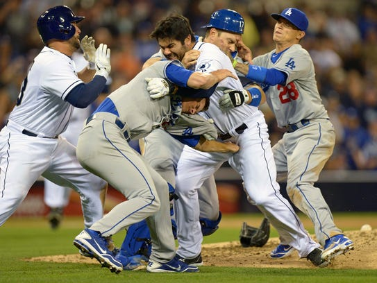 Padres left fielder Carlos Quentin (middle right) and
