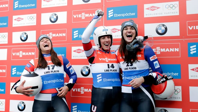 Erin Hamlin, of the United States, center, celebrates after winning the women's luge World Cup in Lake Placid, N.Y., in 2015. Hamlin led a USA sweep with teammates Emily Sweeney, second place, and Glen Rock's Summer Britcher, third place, on Dec. 5. (AP Photo/Mike Groll)