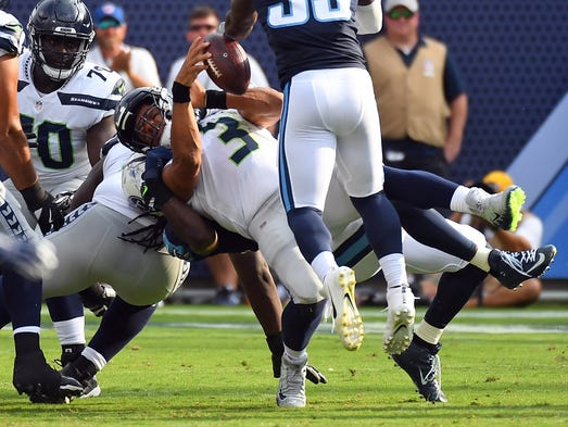 Seattle Seahawks quarterback Russell Wilson is sacked