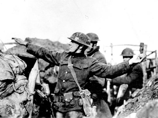 An American solider from the First Division throws a hand grenade in battle during World War I along the Western Front in France on March 15, 1918.
