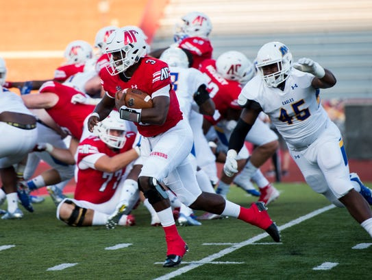 Quarterback JaVaughn Craig (3) runs in for Austin Peay's