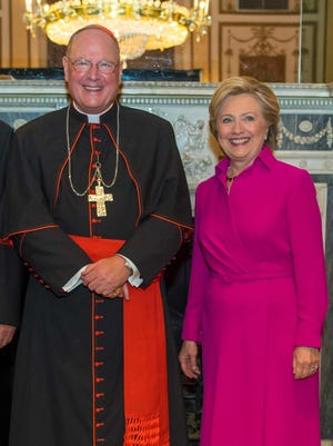 All smiles: Cardinal Timothy Dolan and Democratic presidential nominee Hillary Clinton.