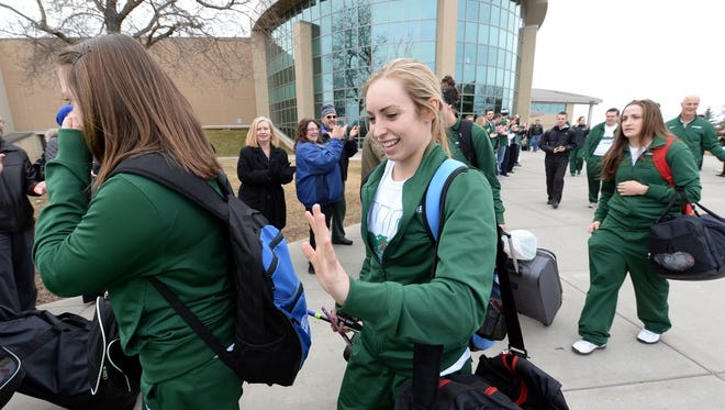 UW-Green Bay's Megan Lukan high fives friends gathered Thursday at the Kress Center in Green Bay to wish the Phoenix women's basketball team well as they leave for the NCAA tournament game in Maryland.