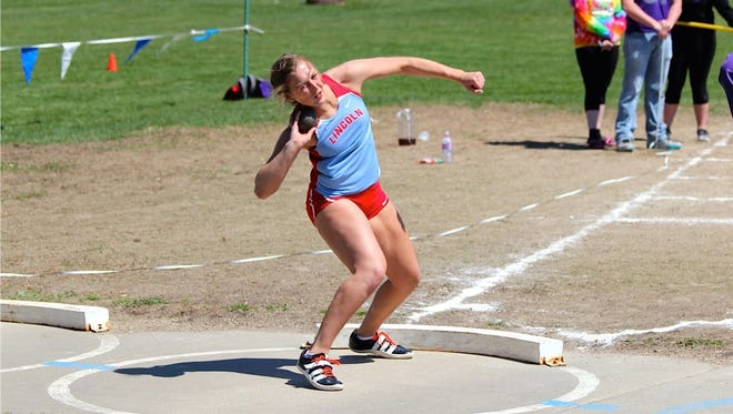Lincoln's Izzy Van Veldhuizen competes in the shot put at a meet earlier this season. Van Veldhuizen holds the top marks in the state in both the discus and shot put.