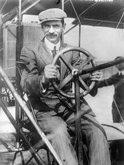 Glenn Curtiss at the pilot's wheel of his biplane. Curtiss planes were built in Hammondsport.