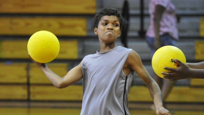 Maurisio Brosinski, 10, plays dodgeball during the Red Shield Kids Camp at The Salvation Army Magness-Potter Community Center.