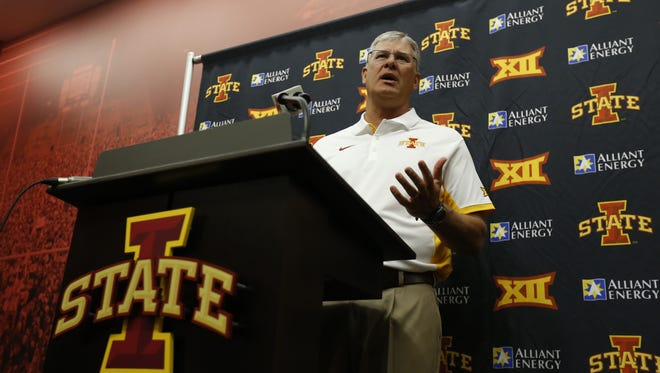 Head football coach Paul Rhoads answers questions from members of the media Thursday, Aug. 6, 2015 during the Iowa State University football media day in Ames.