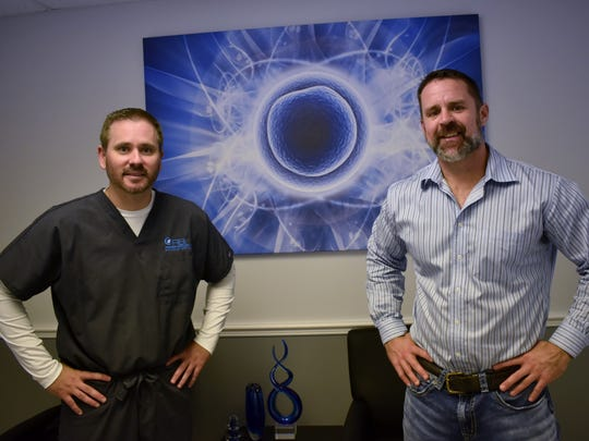 Regenerative Biologics Institute Managing Director Jason Griffeth and Medical Director Dr. Brett Haake stand in their office, located across from Indian River Medical Center in Vero Beach.