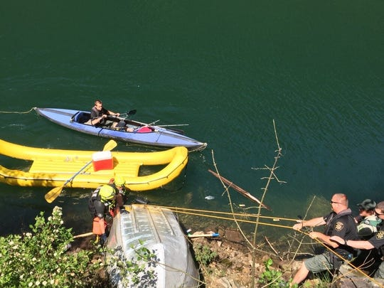 Marion County Sheriff's Office Marine Patrol Unit deputies recovers an Aumsville couple's boat from Big Cliff Reservoir on Monday, May, 30, 2016.