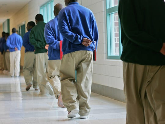 Students walk down the hallway to lunch after class