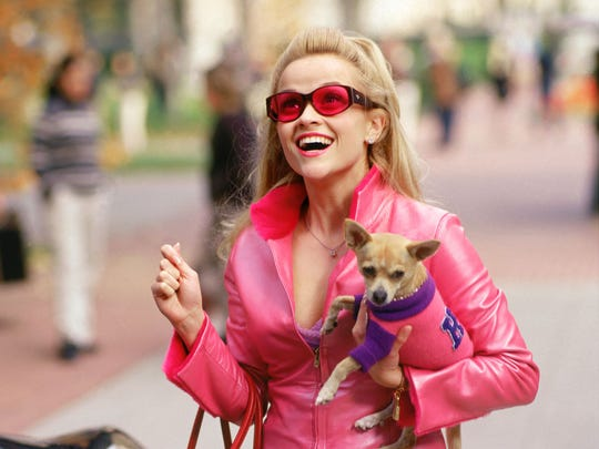 "Reese Witherspoon in ""Legally Blonde"" proving orange"