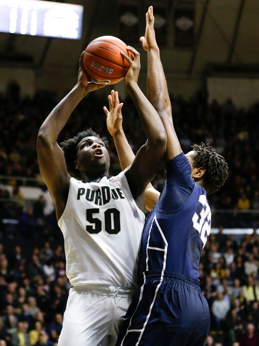 Purdue forward Caleb Swanigan (50) shoots over Penn State center Jordan Dickerson (32) during the second half of an NCAA college basketball game in West Lafayette, Ind., Wednesday, Jan. 13, 2016. (AP Photo/Michael Conroy)