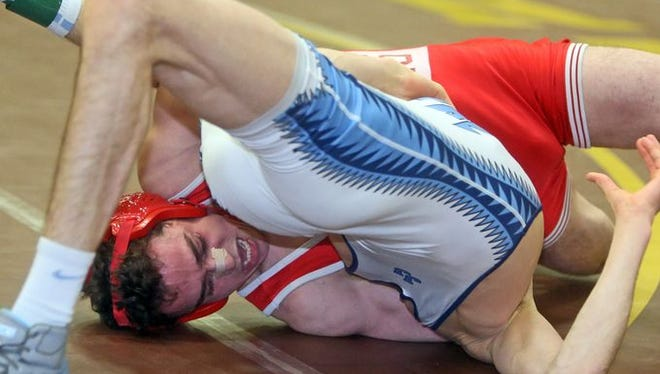 Anthony Sulla of North Rockland pinned Randy Earl of John Jay East Fishkill to win the 106 pound title at the Division 1 sectional wrestling championships at Clarkstown South High School Feb. 15, 2015.