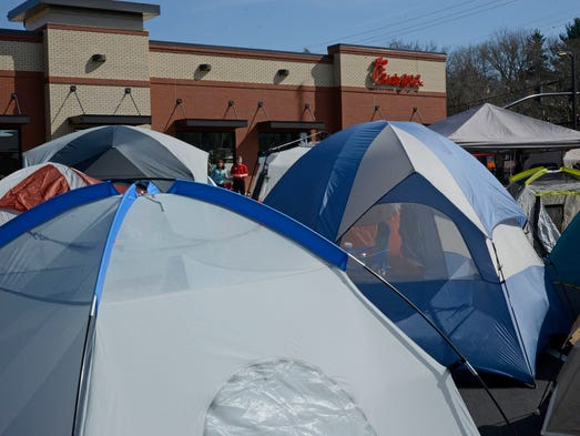 More than 100 people camped out in the parking lot of new Merrimon Avenue Chick-fil-A Wednesday to recieve free Chick-fil-A sanwiches for one year. The company hosts these events for every new store that opens providing games, music, bathrooms and more for the campers. 4/2/14. Robert Bradley (rbradley@citizen-times.com)
