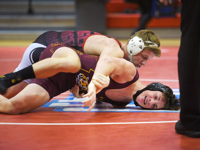 Vermillion's Trey Hage wrestles Harrisburg's Jacob
