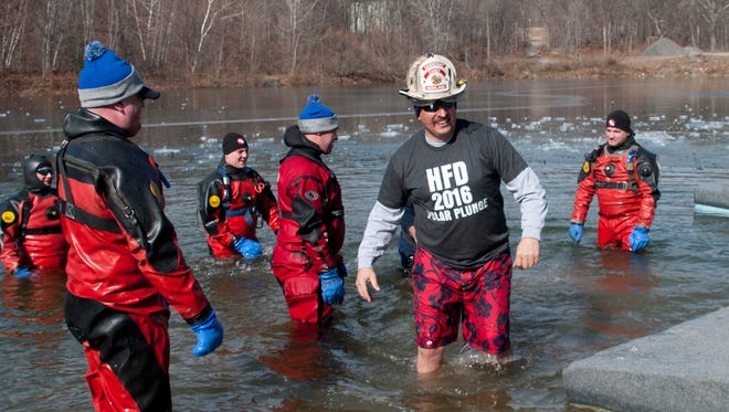 Jimmy Anzalone leaves the water in his fireman's hat and shirt at last year's Subzero Heroes.