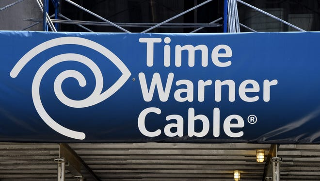 A view of a sign at a Time Warner Cable office in New York, New York, USA, 26 May 2015.