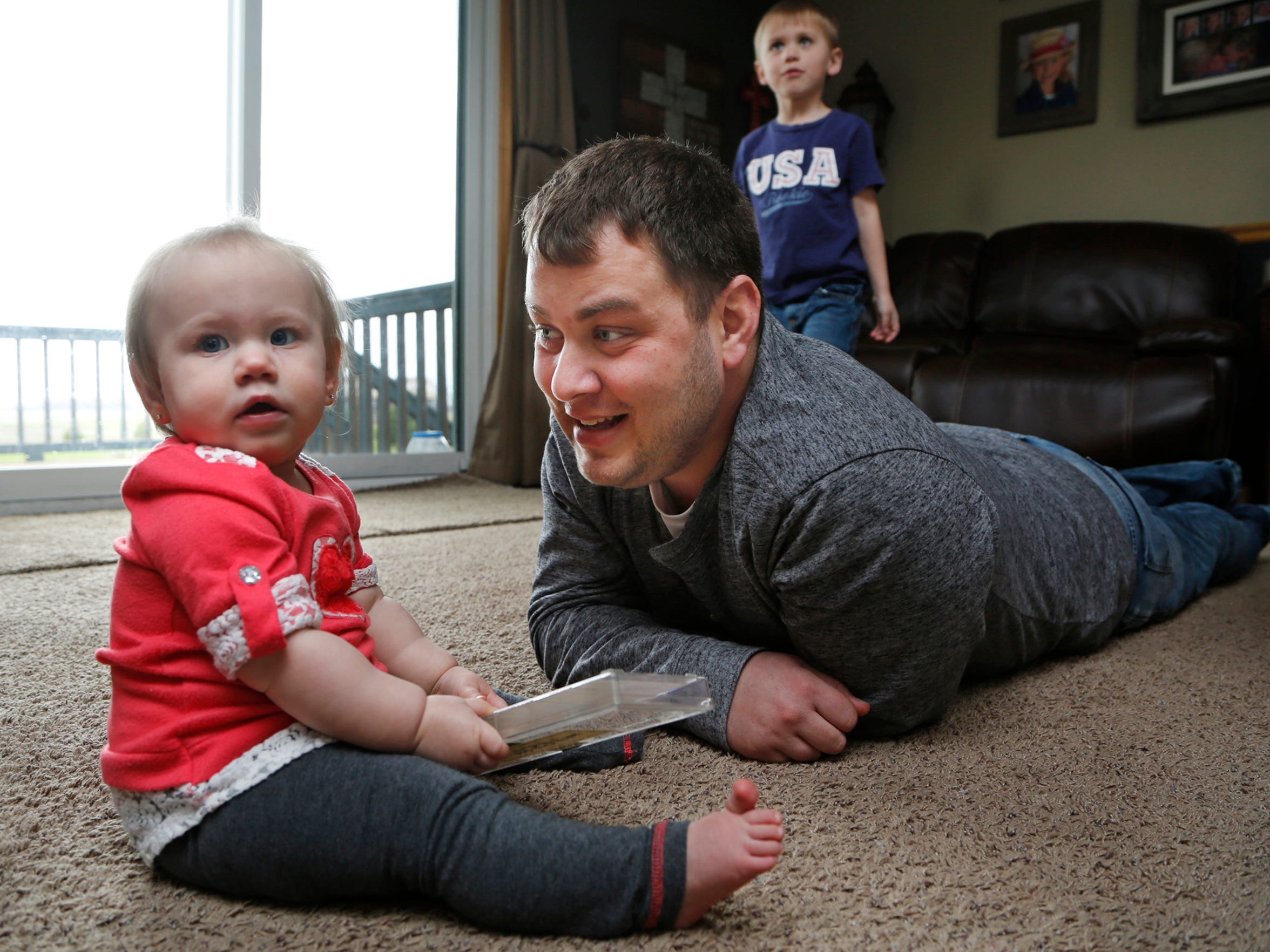 Nathan Hrnicek plays with daughter Adylae, 11 months,