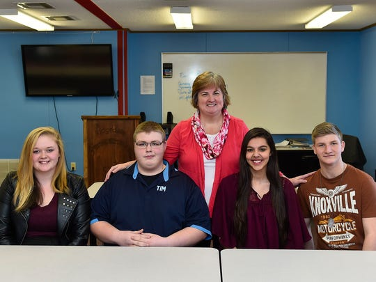 Senior class members of the Ridgedale career-based intervention program are, seated from left, Tori Barlow, Tim Stewart, Abby Schugg and Dakota Kokas. Lori Martin, standing,  teaches the program.