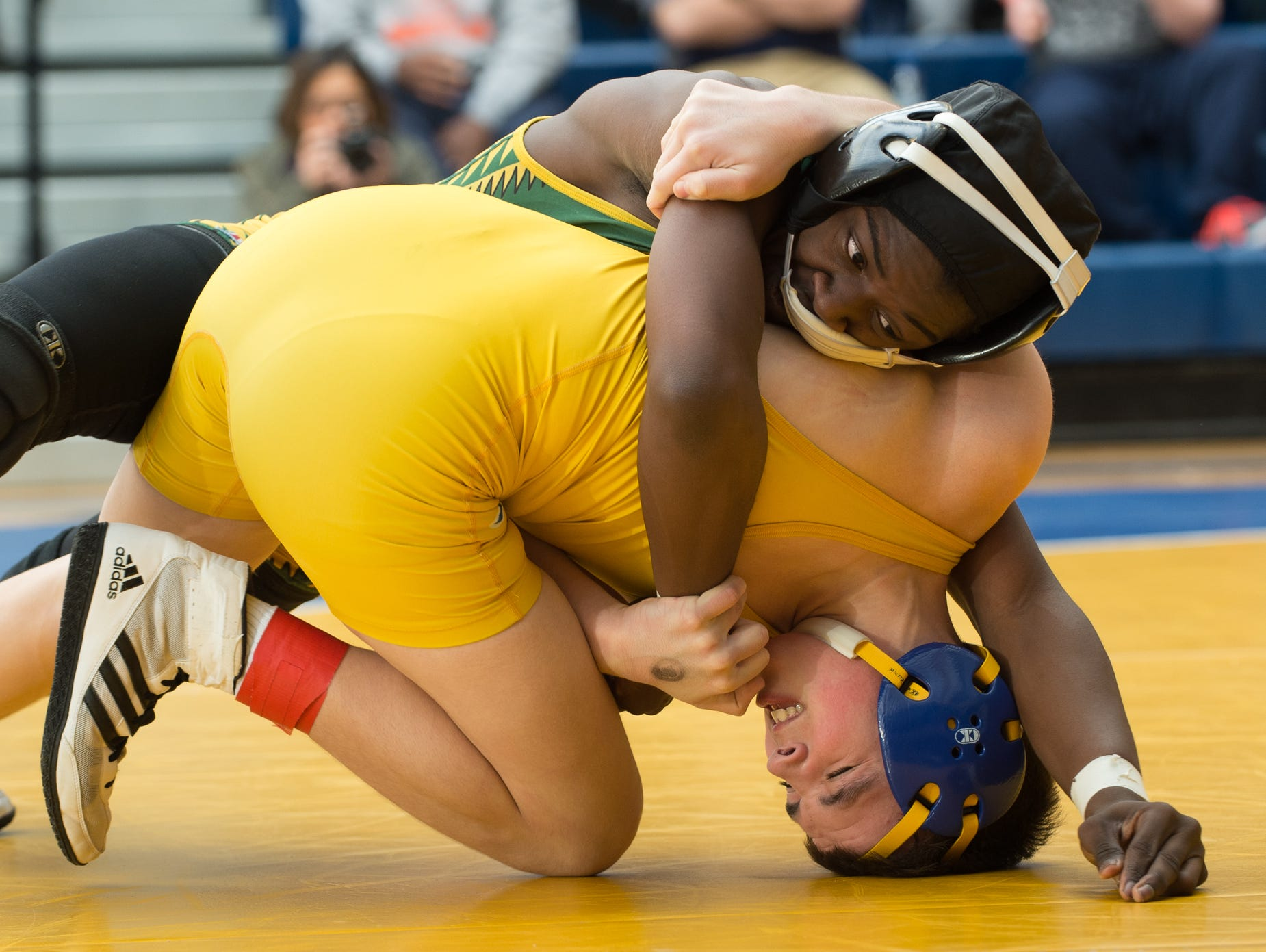 Indian River's Will Rayne (top) holds Caesar Rodney's Michael Primo down on the mat in the 106 pound championship match at the Henlopen Conference wrestling tournament at Sussex Central High School.