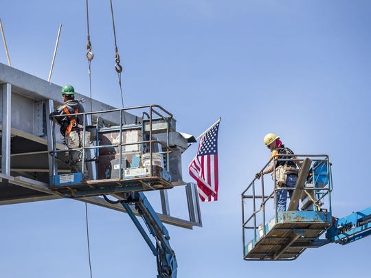 Workers continue construction on the new library off of Del. 9 in New Castle last week.