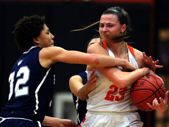 Pingry at Somerville girls basketball. Emily Markowski fights off Pingry's Kelsey Ransom Thursday January 11, 2018 photo by Ed Pagliarini