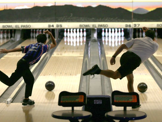 Bowlers Nick Myers, 14, left, and father Russ Myers