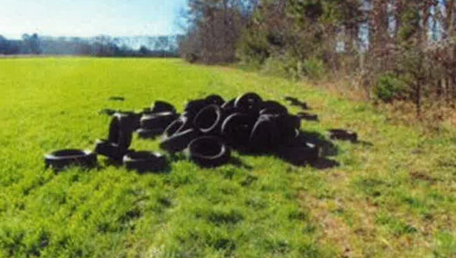 Pictured are 60 tires that were dumped on a farm field near Machipongo that is owned by the Nature Conservancy. Over 200 tires were dumped in the vicinity of the farm field in January.