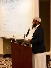Imam Noman Hussain giving a presentation on Islam during the Open Mosque Day event.