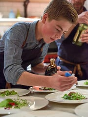 Chef and restaurateur Victor Rallo watches as his son Jake, 16, prepares a meal during a recent Good Folk Supper Club event.