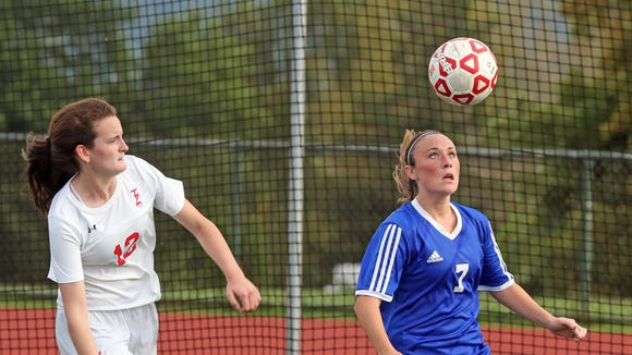 Pearl River's Kate McNally (7) keeps the ball away from Tappan Zee's Kaliegh Beirne (12) during girls soccer game at Tappan Zee High School Sept. 20, 2017.