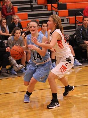 Danbury's Alyx Perram drives to the basket Thursday against Gibsonburg's Katy Roberts.