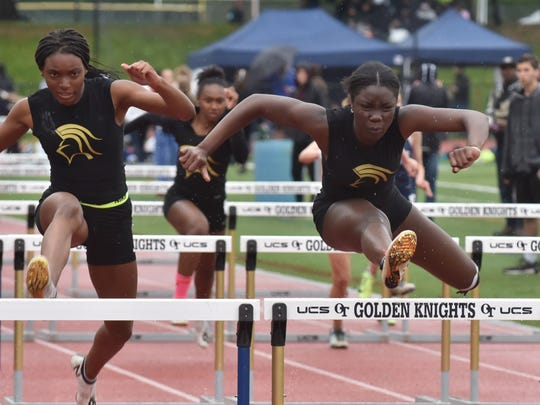Isabelle Dely, right, of Paramus Catholic wins in 110m hurdles on the Second Day of Bergen Track championships on Saturday, May 12, in Old Tappan, NJ.