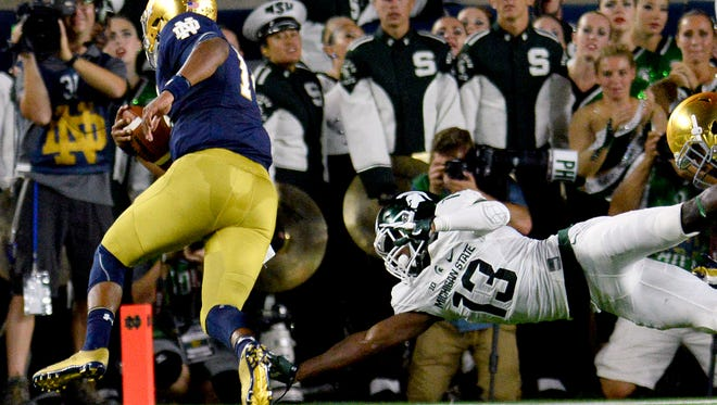 Michigan State University  sophomore cornerback Vayante Copeland (13) dives to try and stop Irish quarterback DeShone Kizer from getting into the endzone for the game's first touchdown in the first half of the Spartans game against Notre Dame Saturday, Sept. 17, 2016 in South Bend, Ind.