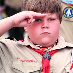 Boy Scout Scott Theen from Troop 413 stands at attention during the singing of the national anthem at Chesapeake City Hall for the annual Memorial Day ceremony Monday, May 28, 2012, in Chesapeake, Va. The Boy Scouts of America is rolling out a new science-and-technology based program.