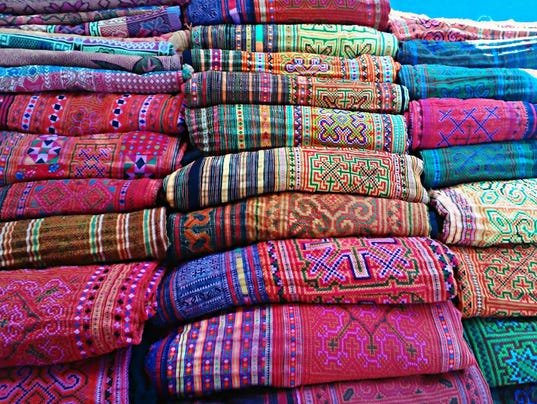 Colorful Hilltribe Hmong Fabric at market stall.