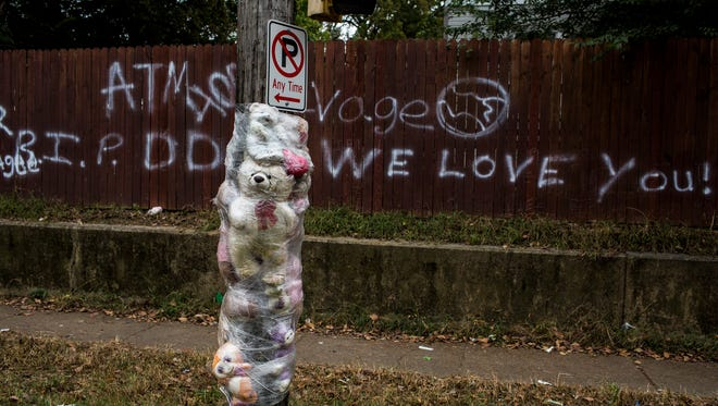 October 20, 2016 - Teddy bears plastic-wrapped to a pole and a fence spray-painted with condolences mark the scene along Vollintine Avenue near Northside High School in North Memphis where Demarious Harris, 16, was found suffering from a gunshot would to the head in October 2015. Johntavius Griggs, 20, was indicted on first-degree murder charges for the shooting.