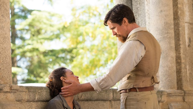 """American reporter Chris Myers (Christian Bale) is involved with Ana (Charlotte Le Bon) in """"The Promise."""""""