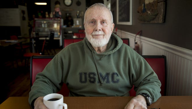 Jim Chandler, 82, is a Marine veteran who has voted Republican since Eisenhower. He voted for Trump and doesn't regret it. Chandler poses for a portrait at the Corner Diner in Bethel, Ohio Wednesday, January 17, 2018.