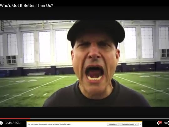 Wolverines coach Jim Harbaugh recorded a music video with rapper Bailey.