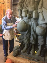 Sculptor Garland Weeks works on the clay sculpture