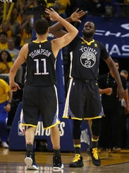 Golden State Warriors' Klay Thompson (11) and Draymond