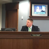 Pam Burton (on the TV) addresses council during the May 2 meeting. Also pictured are council members Tom Brinker and Lucas Deaton.