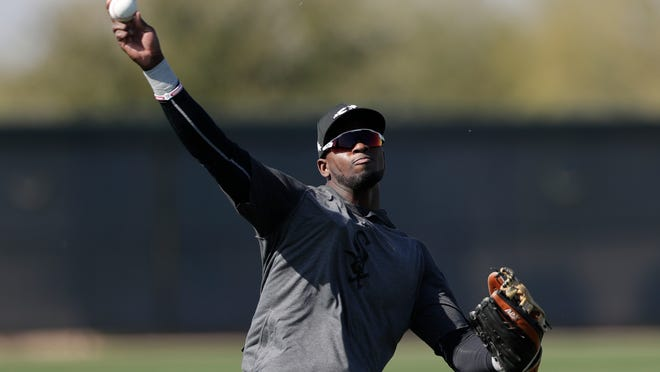 In this Monday, Feb. 17, 2020, file photo, Chicago White Sox center fielder Luis Robert throws the ball during spring training baseball in Phoenix. The 22-year-old Robert joins a formidable White Sox lineup after agreeing to a $50 million, six-year contract in January.