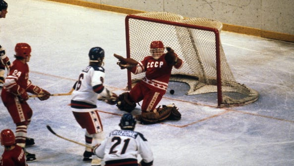 Team USA's Mike Eruzione (21) in action, scoring goal to take 4-3 lead in third period vs. USSR at Olympic Fieldhouse in the Olympic Center.