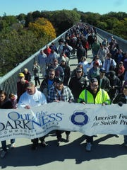 People march in a 2012 suicide prevention walk on the