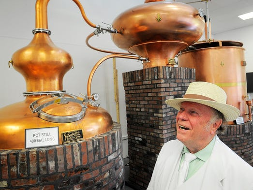 Phil Prichard looks over his alembic still at the grand