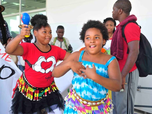Naturi Swink, 11, and Trinity Greene, 9, lead the African Heritage Parade and Festival at Global Event Center at the Global Mall at the Crossings  in Nashville, Tenn., on Sept. 1, 2014.