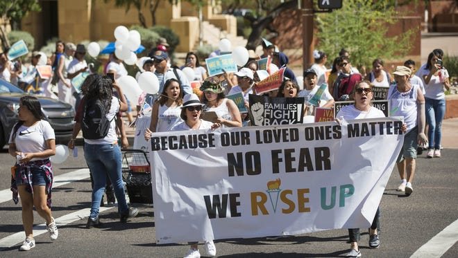 Phoenix families, including teens and children, march toward Phoenix City Hall on April 30, 2017. Promise Arizona held a march and rally against deportation efforts and to support immigrant communities.